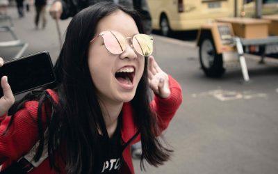 Girl cheering in street